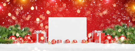 Blank Christmas card laying on red baubles and gift on red background 3D rendering 免版税图像