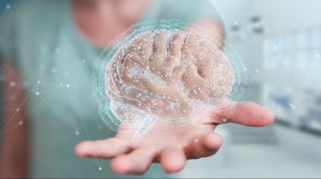 Zakenvrouw op onscherpe achtergrond met behulp van digitale 3D-projectie van een 3D-rendering van het menselijk brein Stockfoto