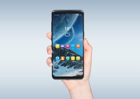 Woman hand holding modern smatphone mockup on grey background