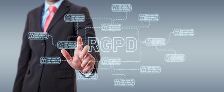 Businessman on blurred background protecting his datas with GDPR law interface 版權商用圖片