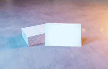 Stack of business card mockup on concrete background 3d rendering Banco de Imagens