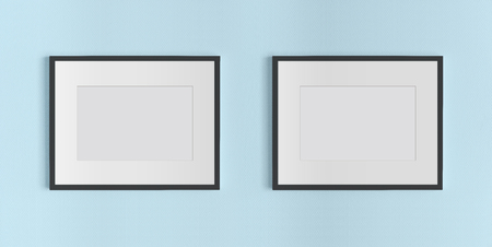 Two black frames hanging on a blue textured wall mockup Stock Photo