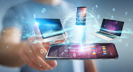 Modern devices connected to each other in businessman hand 3D rendering Stock Photo