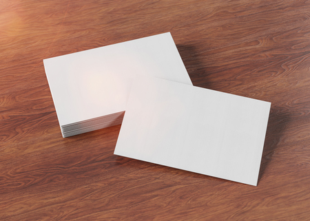 Pila de tarjetas de visita blancas en la representación 3d de la maqueta del escritorio de madera