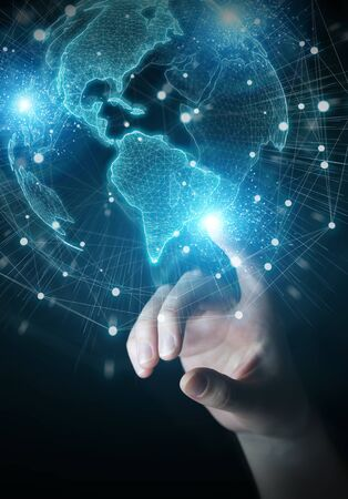 Businessman hand in dark using America USA map globe network hologram 3D rendering Reklamní fotografie
