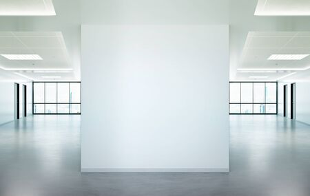 Blank squared wall in bright office mockup with large windows and sun passing through 3D rendering Stock Photo