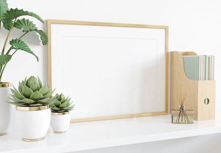 Golden frame leaning on white shelve in bright interior with plants and books mockup 3D rendering