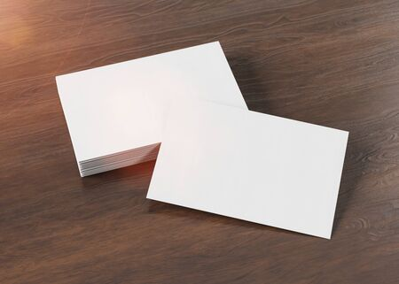 White business card pile on wooden desk mockup 3d rendering Stok Fotoğraf