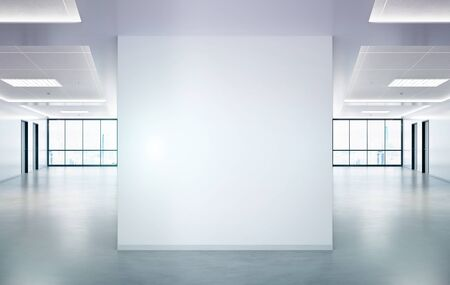 Blank squared wall in bright office mockup with large windows and sun passing through 3D rendering 写真素材
