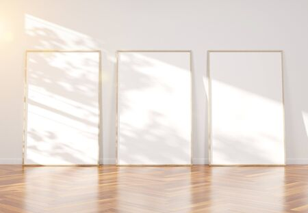 Three wooden frame leaning in bright wooden interior mockup 3D rendering Фото со стока