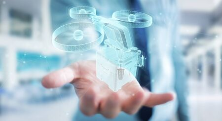 Businessman on blurred background holding and touching holographic delivery drone projection in his hand 3D rendering