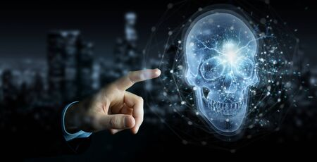 Man hand on dark background using digital x-ray skull holographic scan projection 3D rendering Stock Photo