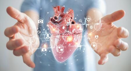 Man on blurred background using digital x-ray of human heart holographic scan projection 3D rendering