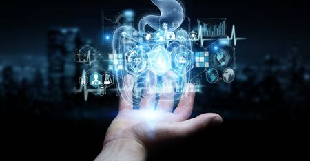 Man hand on dark background using digital x-ray of human intestine holographic scan projection 3D rendering