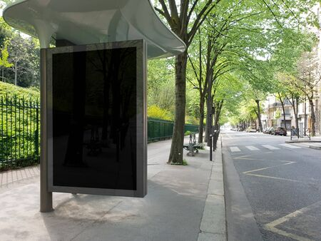 Black bus stop billboard Mockup in empty street in Paris. Parisian style hoarding advertisement close to a park in beautiful city