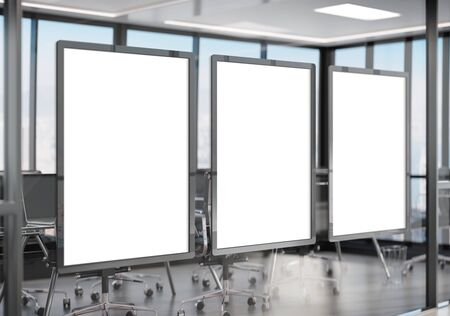 Three white frames Mockup hanging on office glass window. Mock up of a billboards in modern company interior Archivio Fotografico