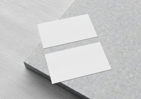 Two white US business card Mockup on concrete background. American size calling card front and back laying on blank surface 3D rendering