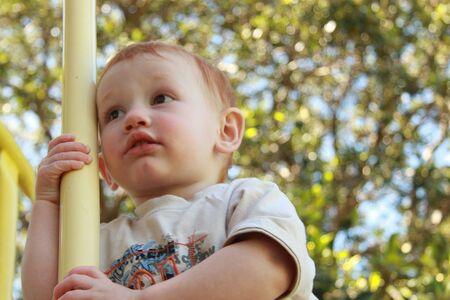 Boy watching on playground equipment Stock Photo - 4545476