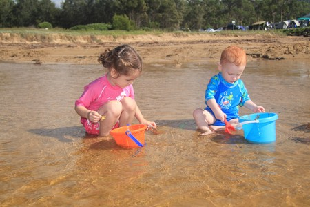 Young boy and girl playing in water at beach Stock Photo - 4545479