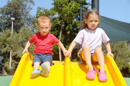 Kids on slide Stock Photo - 4567403