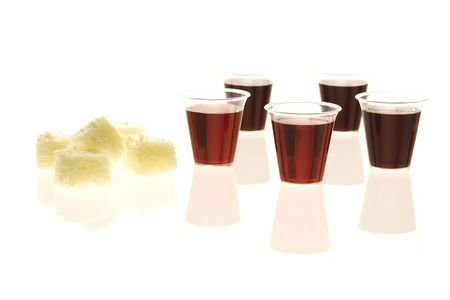 Multiple communion cups with wine and bread Stock Photo