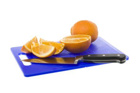 Freshly cut orange pieces on chopping board Stock Photo - 4936570