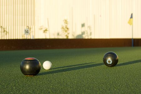 boules: Lawn bowls in the late afternoon sun