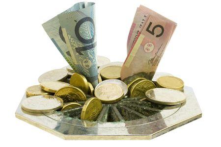going down: Concepto de monedas y billetes va por el desag�e. Aislado en blanco. Foto de archivo