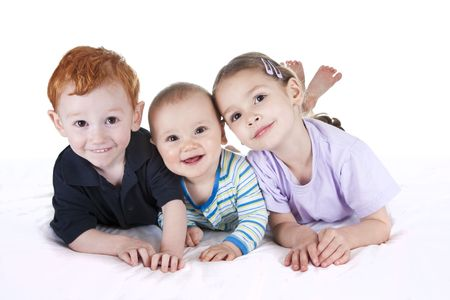 Three kids on white bed with isolated background
