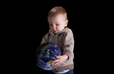 conservationist: Boy holding and looking at the world isolated on black. Earth image courtesy of NASA.