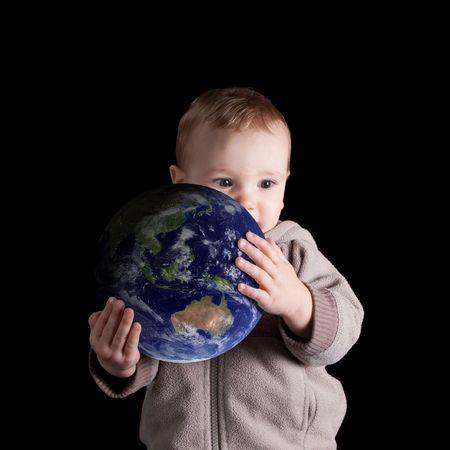 conservationist: Toddler holding globe isolated on black. Earth image courtesy of NASA. Stock Photo