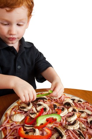 Young boy preparing homemade pizza closeup isolated on white photo