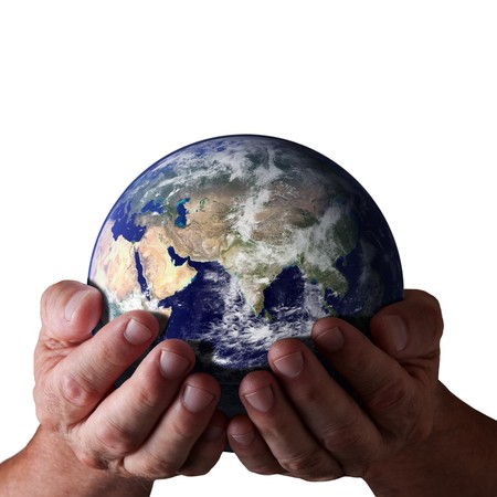 Concept of caring for earth. Hands holding world with isolated black background. Earth image courtesy of NASA. photo