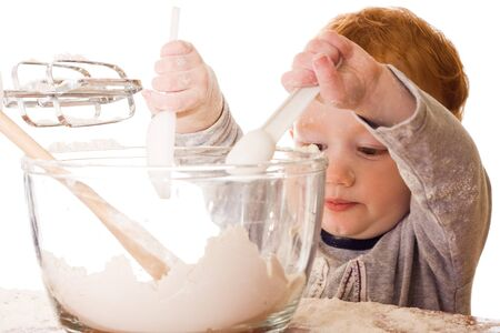 Boy cooking, mixing, and making mess. Isolated on white Stock Photo - 7116993