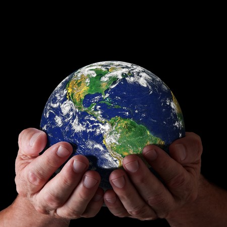 Hands holding world with north and south america. Earth image courtesy of NASA photo