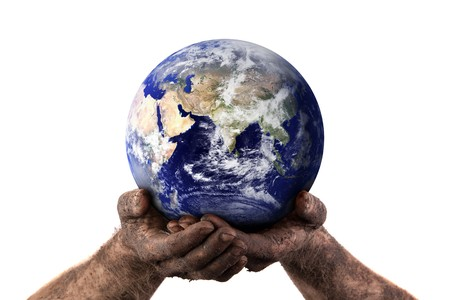middle east crisis: Dirty hands holding the world showing the dry middle east. Isolated on white. Earth image courtesy of NASA. Stock Photo