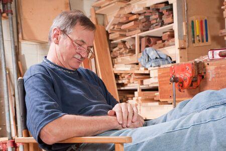 Senior man sleeping in chair in workshop Stock Photo - 8723952