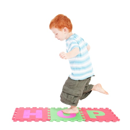 Boy hopping on word hop. Isolated on white. Standard-Bild