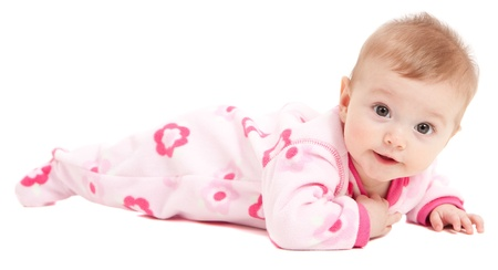 lying on the stomach: Cute baby girl in pink isolated on white