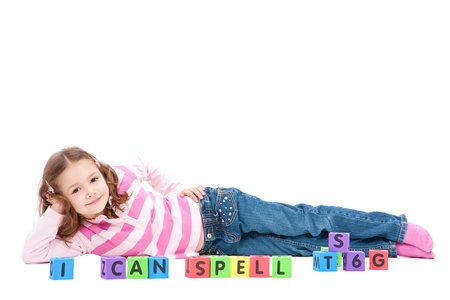 i kids: Girl with kids blocks saying I can spell. Isolated on white.