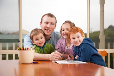 Dad coloring kids pictures with children Stock Photo - 10656683