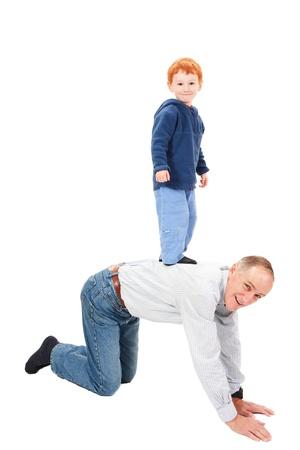 kneel: Boy standing on grandfather