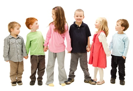 four hands: Group of six happy children standing and holding other kids hands  Isolated on white