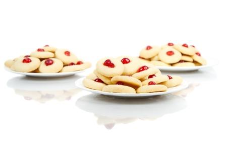 Three plates of homemade cookies on white Stock Photo - 15159983