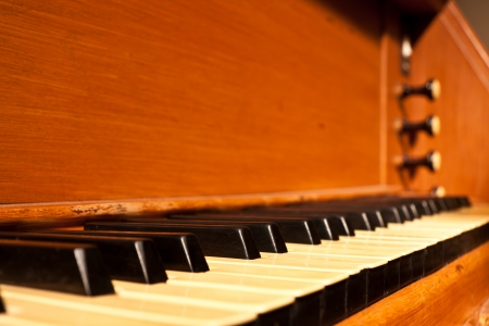 Old vintage pipe-organ keyboard musical instrument photo