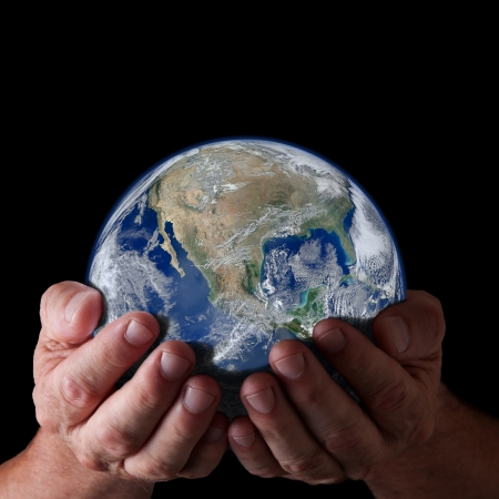 Hands holding world with isolated black background  Earth image,  Concept of caring for earth Standard-Bild