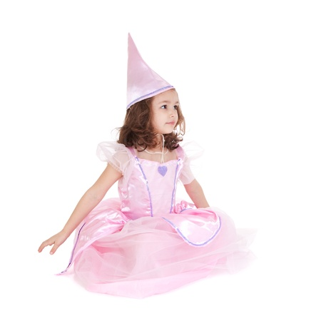 dressups: Young girl dressed as fairy princess sitting isolated on white