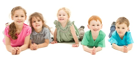 Five happy smiling kids lying in line on floor  On white  Standard-Bild