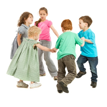 Kids holding hands and playing circle game  On white  photo