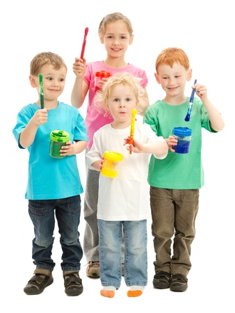 Group of children with kids paint brushes ready to paint photo
